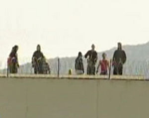 rebels on the roof of the Chania, Crete juridical prison (photo from athens indymedia)