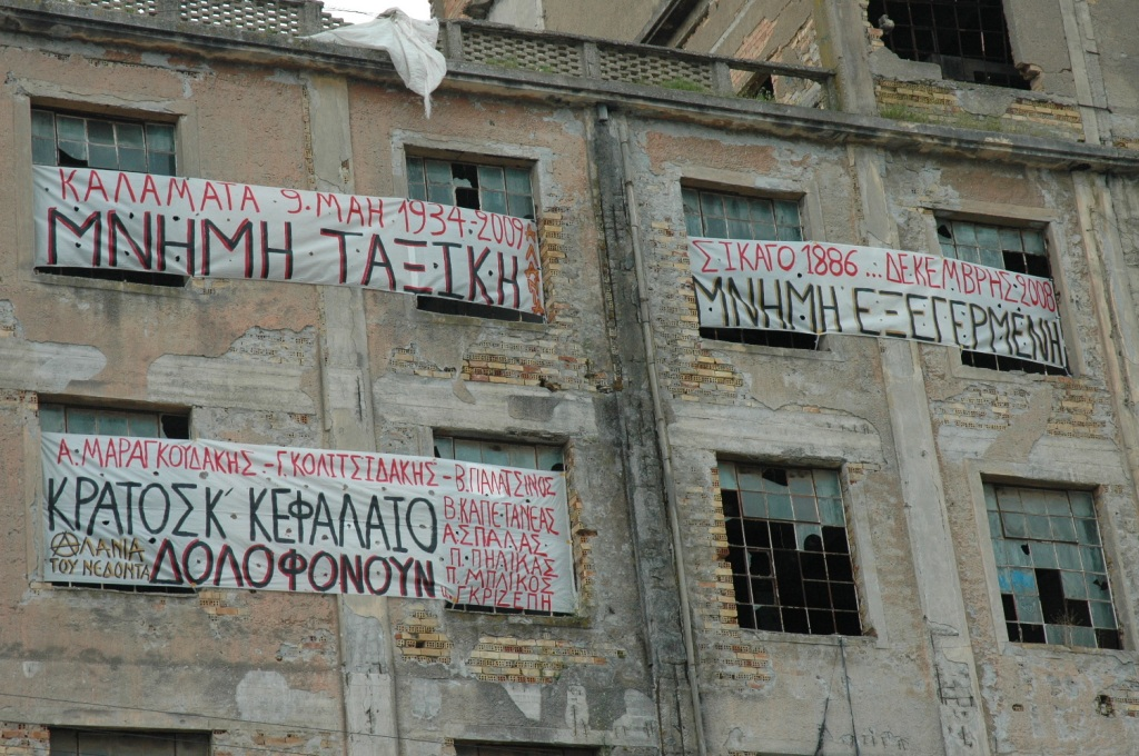 "banners at the symbolic occupation of the town's old wheat mills - ""class memory - revolt memory"""